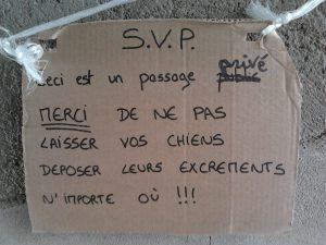 dog poop in france sign