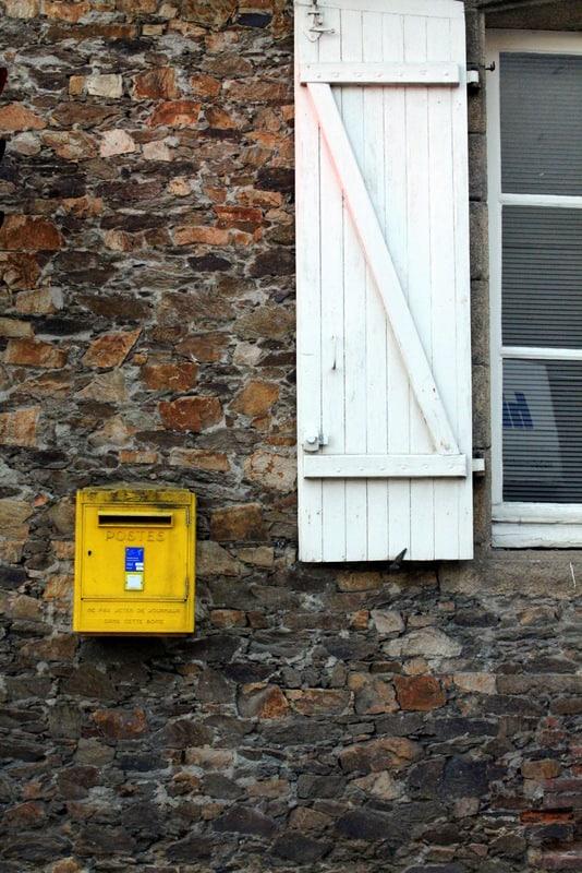 Yellow French mailbox