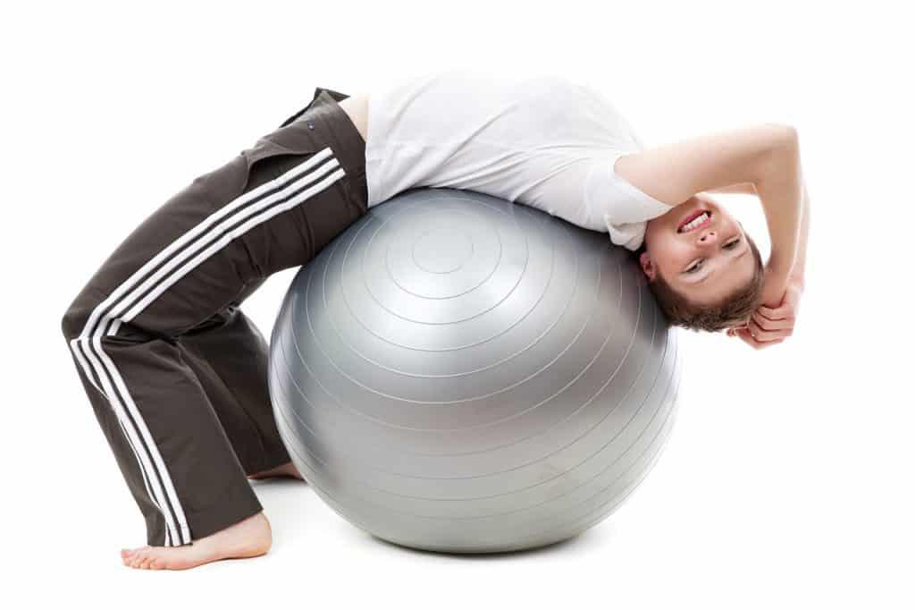 woman on medicine ball france fitness