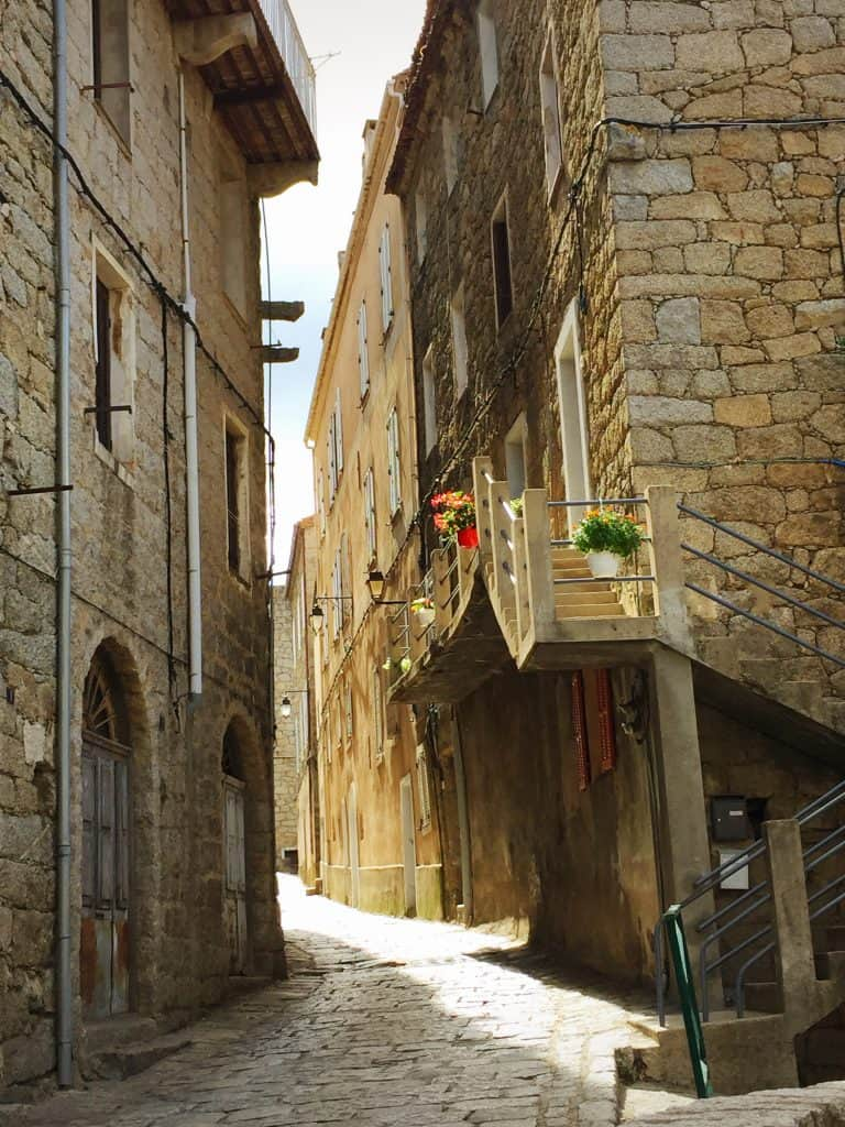 sartene corsica street in afternoon light